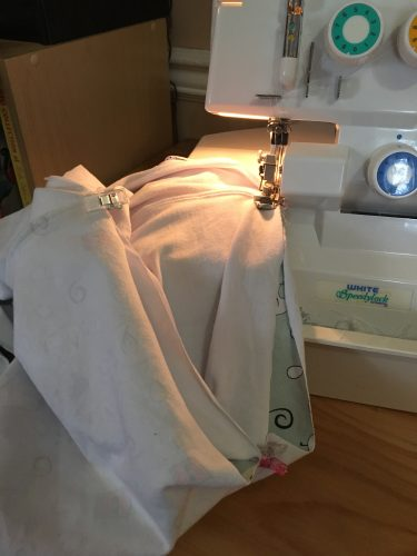 sewing the waistband on the chicken leggings